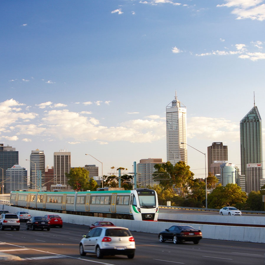 Train with Perth city skyline